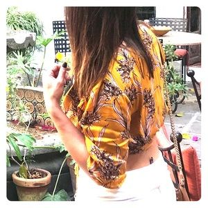 Vacation yellow/gold wrap top w/ floral print